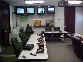 Tables, chairs, phones, and TV screens in the Emergency Coordination Center