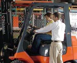 People Operating a Forklift